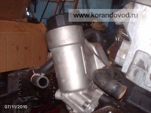 3 - На мотор был установлен корпус масляного фильтра с теплообменником: